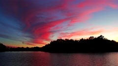 Dramatic sunset over the lake with clouds Stock Footage