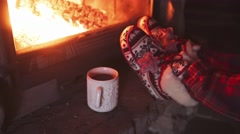 Woman Feet in Comfy red Slippers by Burning Christmas Fireplace. 4K STABILIZED Stock Footage