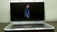 Computer cop walking beat Stock Footage