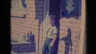 1968: funny boy circles around a pole on the veranda of the house CLARKSDALE Stock Footage