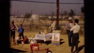 1968: children playing at a yard sale alongside a busy highway CLARKSDALE Stock Footage