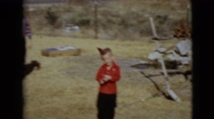 1968: a woman and boys outdoors running about with birthday hats CLARKSDALE Stock Footage