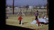 1968: children are seen having fun in a garden area CLARKSDALE, ARIZONA Stock Footage