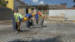 Construction workers installing reinforcement at building site wide by Sheyno. Stock Footage
