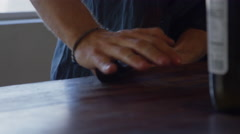 Artisan using hands to work in leather straps Stock Footage