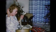1968: a christmas tree is seen with a child opening presents CLARKSDALE, ARIZONA Stock Footage