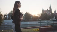 Young Businesswoman Going to Work in Sunny Morning City. SLOW MOTION STEADICAM Stock Footage