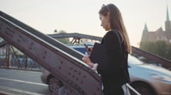 Businesswoman Waking Using SmartPhone in Sunny City. SLOW MOTION. STEADICAM Stock Footage