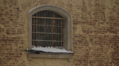 Grille on window of city prison Stock Footage