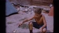 1968: boy playing COTTONWOOD, ARIZONA Stock Footage