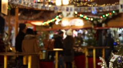 People visit Christmas Fair in old town at evening. Stock Footage
