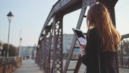 Businesswoman Using Tablet, Going to Work in the City. SLOW MOTION STEADICAM Stock Footage