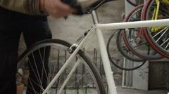 Bicycle Mechanic working on bike Stock Footage