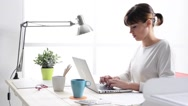 Young woman working with a laptop Stock Footage