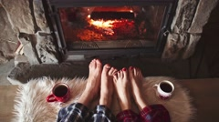 Bare couple feet by the cozy fireplace, 4K. Winter and Christmas. Stock Footage
