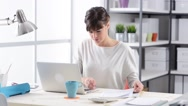 Businesswoman working at home Stock Footage