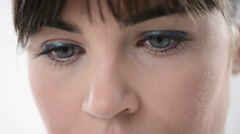 Woman's blue eyes close up Stock Footage