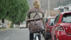 Bicycle rider pedalling down the street Stock Footage