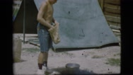 1968: a topless kid is seen pouring in a pot COTTONWOOD, ARIZONA Stock Footage