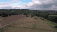 Aerial view of a wood with a pond in North London Stock Footage