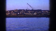 1962: huge cranes are working on the shore of a lake SAN PEDRO, CALIFORNIA Stock Footage
