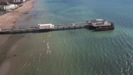 Aerial panning view of the beach and the pier in Worthing Stock Footage