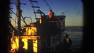 1962: sailing away in the tugboat under the beautiful sunset and clear skies  Stock Footage