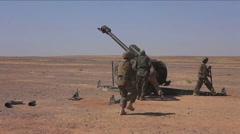 Afghan soldiers fire artillery at the enemy. Stock Footage