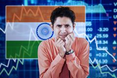 Bankrupt man with Indian flag and graph Stock Photos