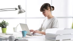 Woman working at home and cuddling her cat Stock Footage