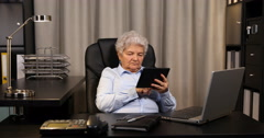 Gray Hair Senior Woman Holding Digital Tablet and Checking Wireless Connection Stock Footage