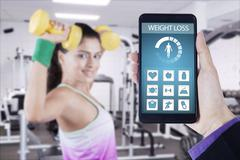 Health app on the smartphone with healthy woman Stock Photos