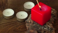 Group of burning candles on wooden background Stock Footage