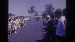 1962: people lined up in a parking lot awaiting an arriving tour train  Stock Footage