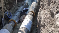 Welding of Pipes in the Earthen Trench Stock Footage