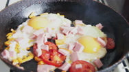 Fried eggs in a pan Stock Footage