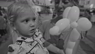 Black-White Mother Daughter at Children Holiday with Balloon Stock Footage