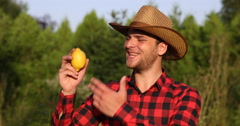 Optimistic Peasant Farmer Man Talking About Lemon in Organic Farm Looking Camera Stock Footage