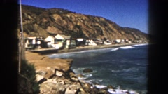 1962: a housing community hugs the shore between the mountains and the ocean. Stock Footage