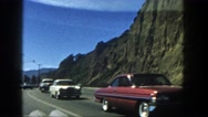 1962: cars are seen passing by a building DISNEYLAND, CALIFORNIA Stock Footage