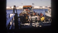 1962: a boat is seen brought into water being pushed down by people DISNEYLAND Stock Footage