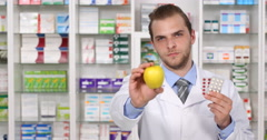 Pharmacist Man Advice Choose Fruit Vitamin Against Medicine Apple Drugs Pharmacy Stock Footage