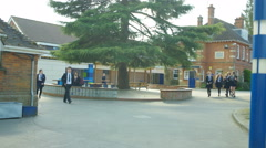 4K Young children walking into school building at the beginning of the day Stock Footage