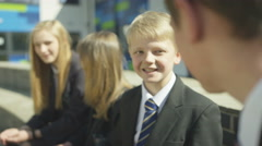 4K Happy school children chatting together outdoors in school yard Stock Footage