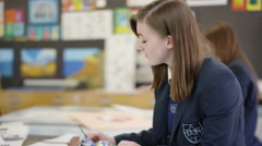 4K Teen girl working quietly on a project in school art class Stock Footage
