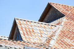 Rusty metal roofing roof as background Stock Photos