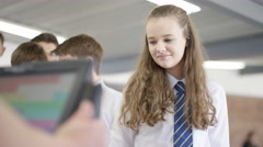 4K Children in school cafeteria queuing up at electronic till to scan food items Stock Footage