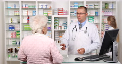 Old Woman in Pharmacy Buy Drugs Medicine Shopping Pharmacist Man Delivery Pills Stock Footage