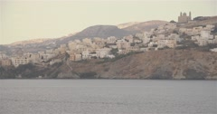 Movement pass by Greek island with authentic village Stock Footage