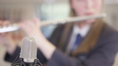 4K Close up portrait of teen girl playing the flute in school music lesson Stock Footage